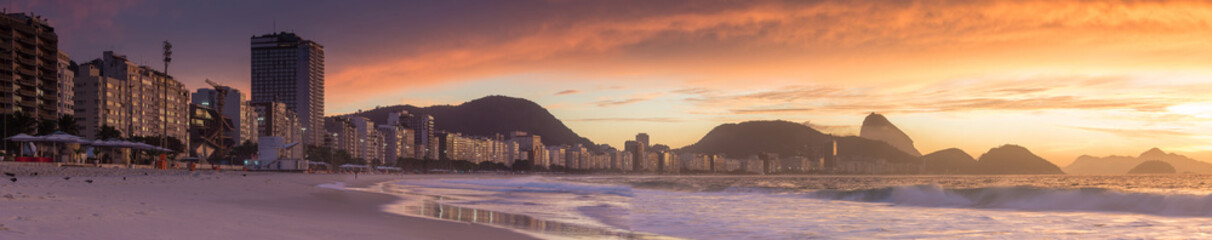 Wall Mural - Sunrise view of Copacabana and mountain Sugar Loaf in Rio de Jan