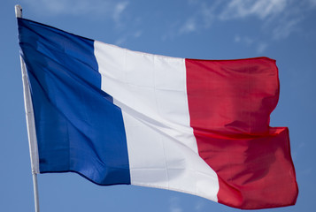 Windy flag of france agains blue sky