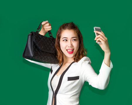 lady show off her new purse by mobile phone