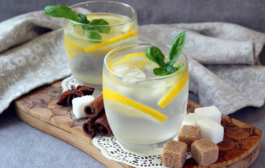 Glasses with cold lemonade and ice cubes..