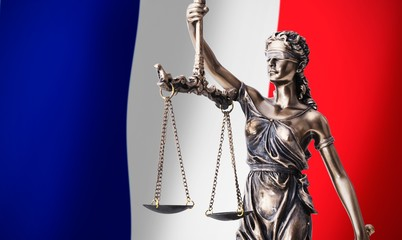 Themis with scale, symbol of justice on French flag background