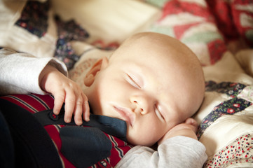Sleeping Baby on a patchwork blanket