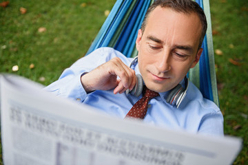 Man resting after work with paper
