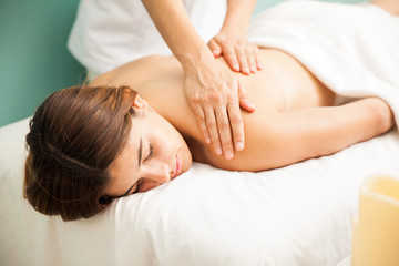 Relaxed woman getting massage at a spa