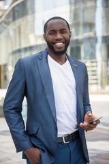 Joyful African man is satisfied with his job