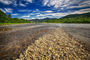 Mountain fast flowing river stream of water