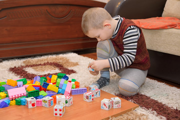 boy playing on the floor