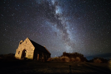 Milky Way Galaxy rising over Church Of God Shepherd, New Zealand. Image noise due to high ISO used