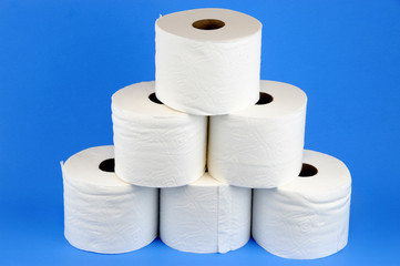toilet paper rolls on blue background