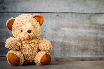 Cute teddy bears sitting on old wood background