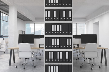 Office with binders and computers