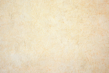 Abstract beige wrinkled paper background