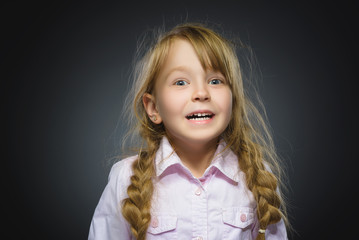 Closeup Portrait happy girl going surprise isolated on gray background