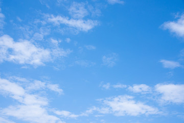 Clear blue sky with white fluffy clouds