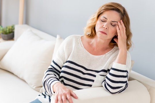 Senior lady feels pain in head