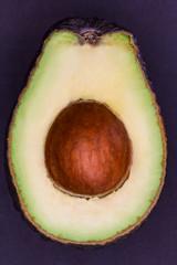 Overhead shot of one avocado cut in half