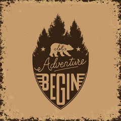 let adventure begin. Emblem with bear silhouette on the forest b