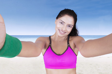 Fitness girl taking a selfie portrait