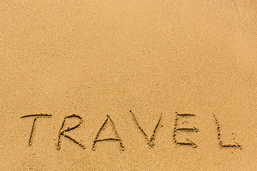 Travel - hand-written on the sand.