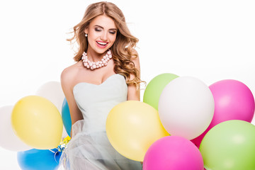 Smiling pretty girl with balloons.