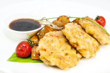 shrimp patties of meat with a salad of eggplant on a white background in restorne