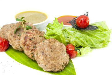 vegetarian meatballs with salad on a white background in restaurant
