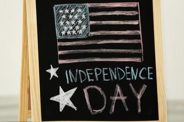 Child's chalk drawing of American flag on blackboard