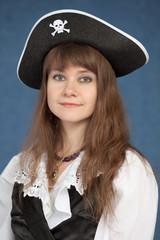 Portrait of pirate girl in black hat