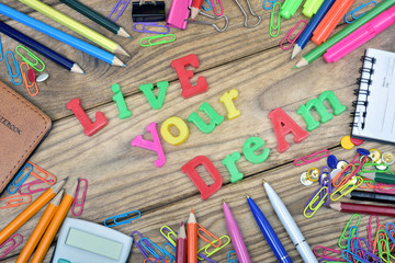 Live your dream text on wooden table