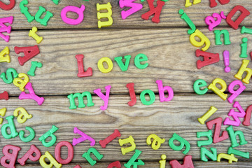 Love my job word on wooden table