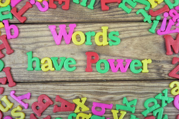 Words have power on wooden table