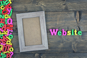 Website on wooden table