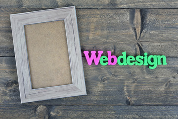 Webdesign on wooden table