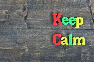 Keep calm on wooden table