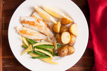 healthy white fish fillets with vegetables