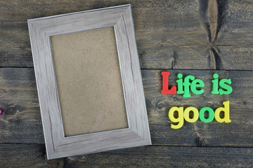 Life is good on wooden table