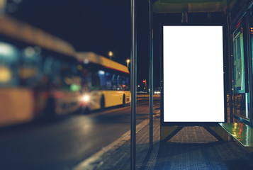 Illuminated blank billboard with copy space for your text message or content, advertising mock up banner of bus station
