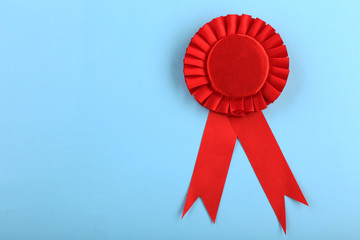 Red award prize ribbon on blue background