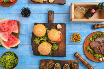 Various burgers, steaks, stuffed zucchini and slices of watermel
