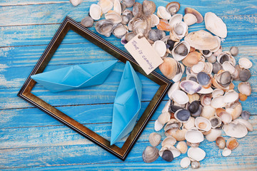 Sign Time is coming with shells and photo frame. Vocation background