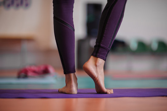 woman standing at yoga class