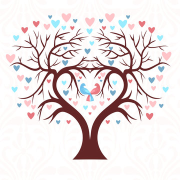 The wedding tree in the shape of a heart with two birds and colorful hearts in a leaf