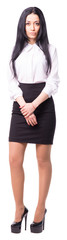 Young business lady standing upright while looking at the camera. Her hands are crossed. White background isolated. Full length cutout portrait.