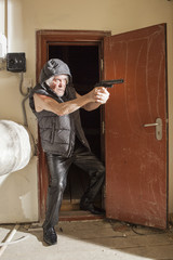 Armed robber with a gun in the attic