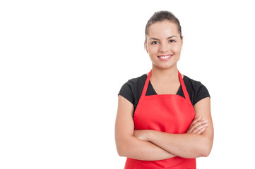 Confident cute employee standing with folded arms