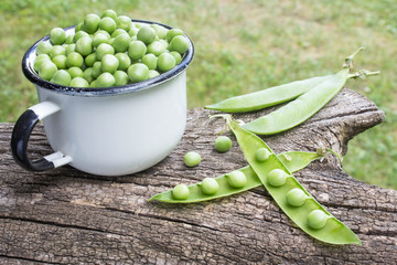 peas in a cup on a stump