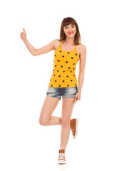 Girl Standing On One Leg And Showing Thumb Up