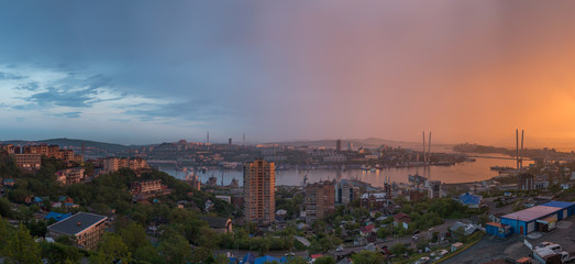 Wall Mural - Vladivostok cityscape, sunset view. Panorama from east to west.