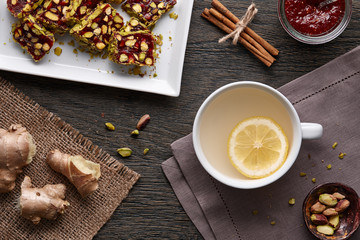 Cup of ginger tea with lemon and turkish delight