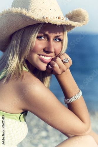 6edb1eb792b84 Beautiful Young Woman on a Beach in Straw Cowboy Hat